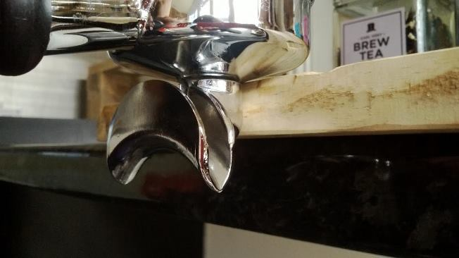 Use a steady flat surface to rest the portafilter